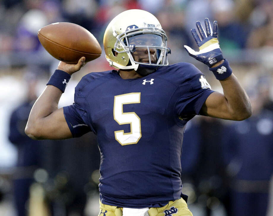 FILE - In this Saturday, Nov. 15, 2014 file photo, Notre Dame quarterback Everett Golson (5) looks to a pass during the first half of an NCAA college football game against Northwestern in South Bend, Ind. Florida State coach Jimbo Fisher says he has met with Everett Golson about the possibility of the former Notre Dame quarterback transferring to the Seminoles, Tuesday, May 12, 2015. (AP Photo/Nam Y. Huh, File)