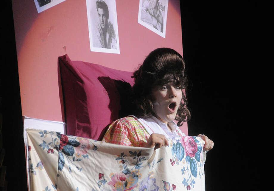 "Krystina Lyons as Tracy Turnblad Tuesday night in a dress rehearsal for ""Hairspray"" at Norwalk High School. Hour photo/Matthew Vinci"