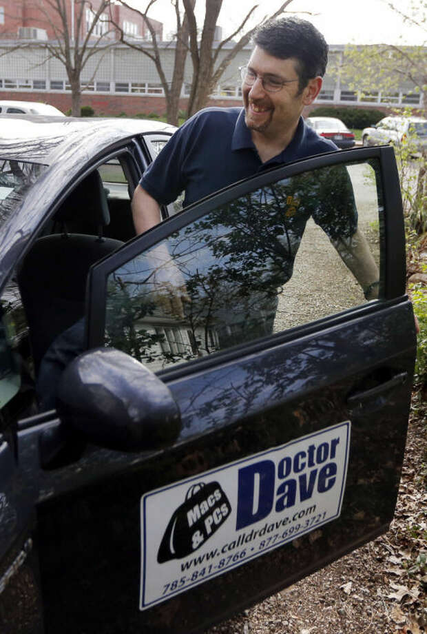 In this Monday, April 21, 2014 photo, Dave Greenbaum, who runs a computer repair business, gets into his vehicle outside his house in Lawrence, Kan. Despite increasing acceptance of gay lifestyles in the U.S., gay small business owners like Greenbaum say they still encounter discrimination from possible customers and investors. (AP Photo/Orlin Wagner)