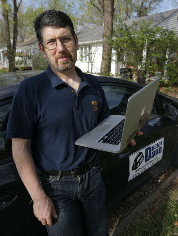In this Monday, April 21, 2014 photo, Dave Greenbaum, who runs a computer repair business, poses for a photograph outside his house in Lawrence, Kan. Despite increasing acceptance of gay lifestyles in the U.S., gay small business owners like Greenbaum say they still encounter discrimination from possible customers and investors. (AP Photo/Orlin Wagner)