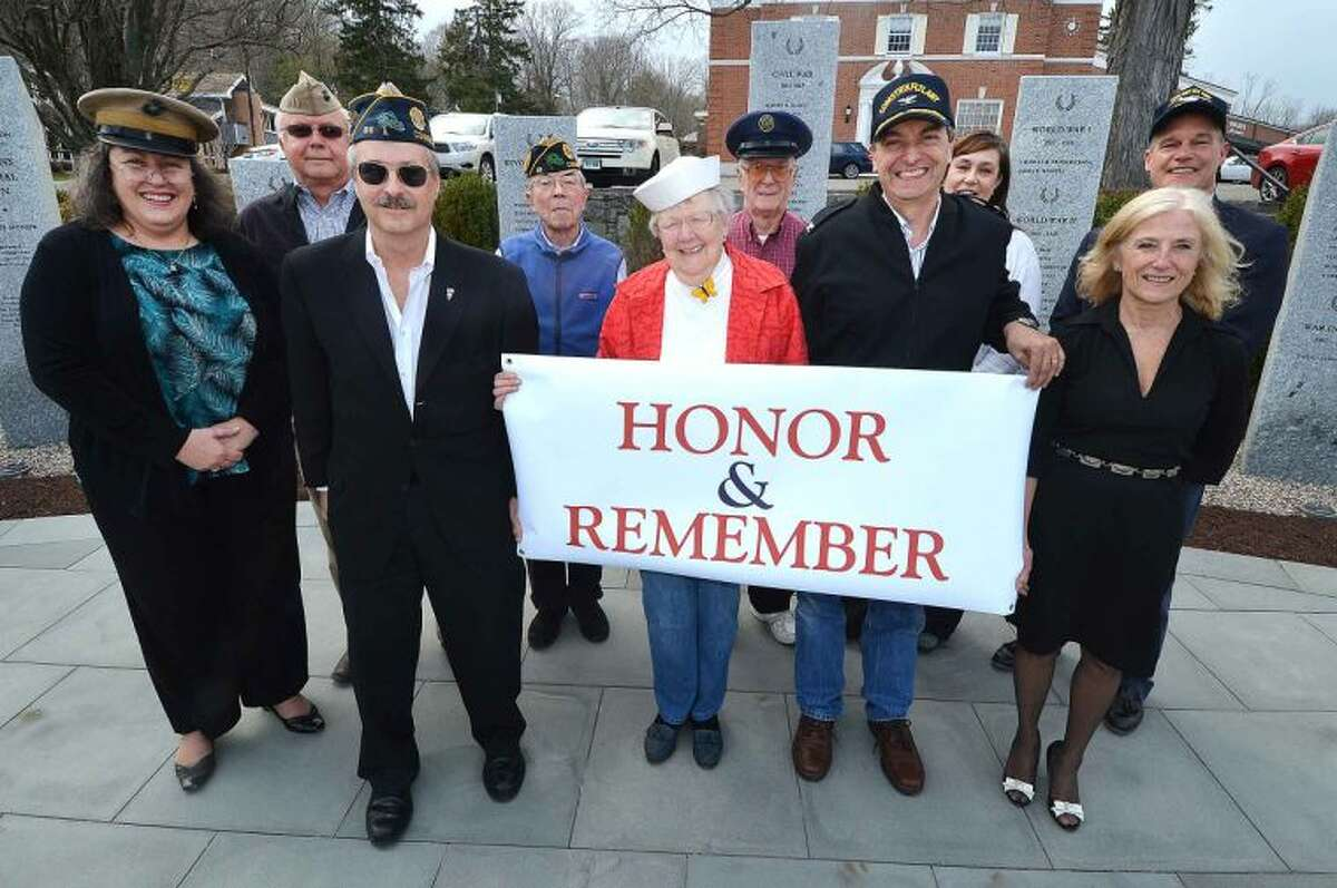 The Wilton Memorial Day Committee poses for a photo in Wilton Center. Pictured from left to right are: Patty Sweeney, Ray Tobiassen, Bud Boucher, Tom Briody, Ann Klotz, Bing Ventres, Bill Glass, Pam Brown, Karen Strickland and Jeff Turner. The committee, chaired this year by Tobiassen, a U.S. Marine Corps veteran, is looking to continue a Wilton tradition that has endured since 1945.