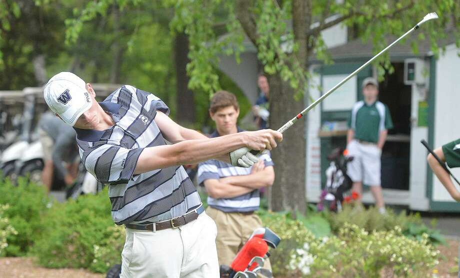 Hour Photo/Alex von Kleydorff Grey Livingstone tees off vs Norwalk