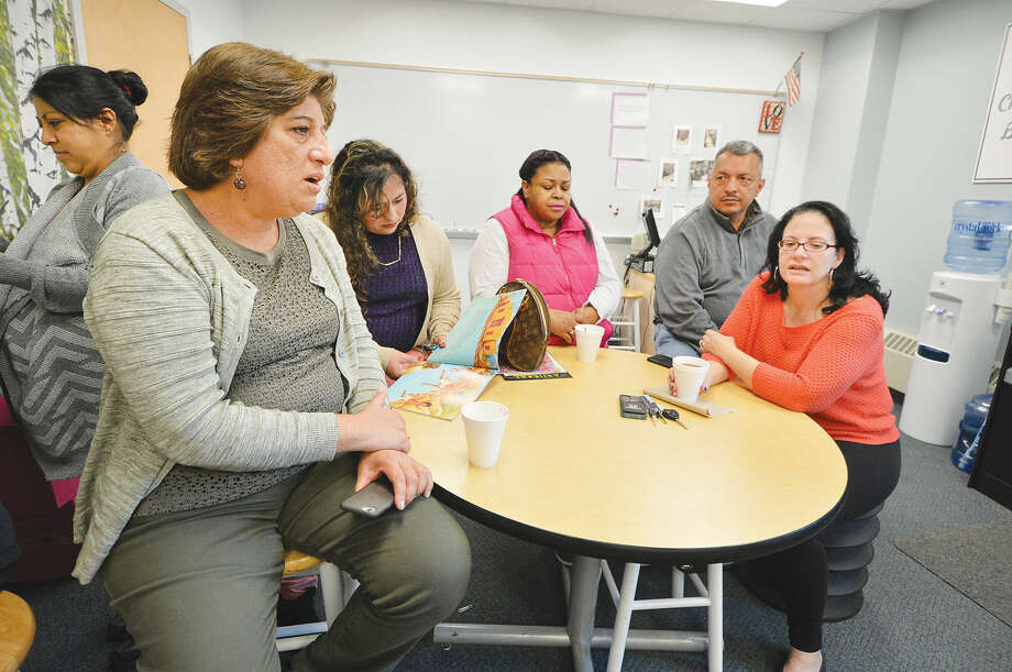 Teacher Mariela Schriel talks with parents of students that have gathered in The Family Center at Brookside School on Thursday April 28 2016 in Norwalk Conn.