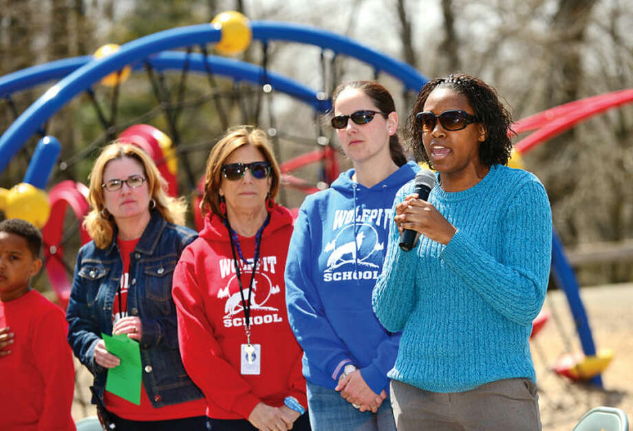 Hour photo / Erik Trautmann First grade teacher April Brown sing the Star Bangled Banner as the Norwalk Tree Advisory Committee, the Norwalk Tree Alliance and the Norwalk Public Schools conduct an Arbor Day Celebration at Wolfpit Elementary School Friday. The program featured a proclamation from Mayor Harry Rilling, remarks by Schools Superintendent Dr. Manuel Rivera, poster contest prizes and the planting of a tree.