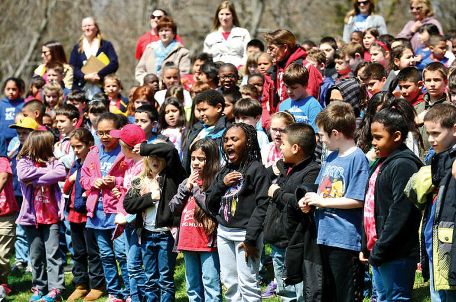 Hour photo / Erik Trautmann The student body says the Pledge of Allegiance as the Norwalk Tree Advisory Committee, the Norwalk Tree Alliance and the Norwalk Public Schools conduct an Arbor Day Celebration at Wolfpit Elementary School Friday. The program featured a proclamation from Mayor Harry Rilling, remarks by Schools Superintendent Dr. Manuel Rivera, poster contest prizes and the planting of a tree.