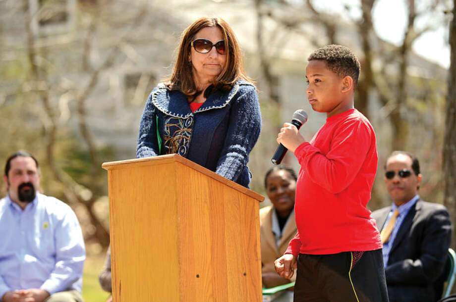 "Hour photo / Erik Trautmann 5th grader Noah Maldanado reads his poem ""Trees"" as the Norwalk Tree Advisory Committee, the Norwalk Tree Alliance and the Norwalk Public Schools conduct an Arbor Day Celebration at Wolfpit Elementary School Friday. The program featured a proclamation from Mayor Harry Rilling, remarks by Schools Superintendent Dr. Manuel Rivera, poster contest prizes and the planting of a tree."