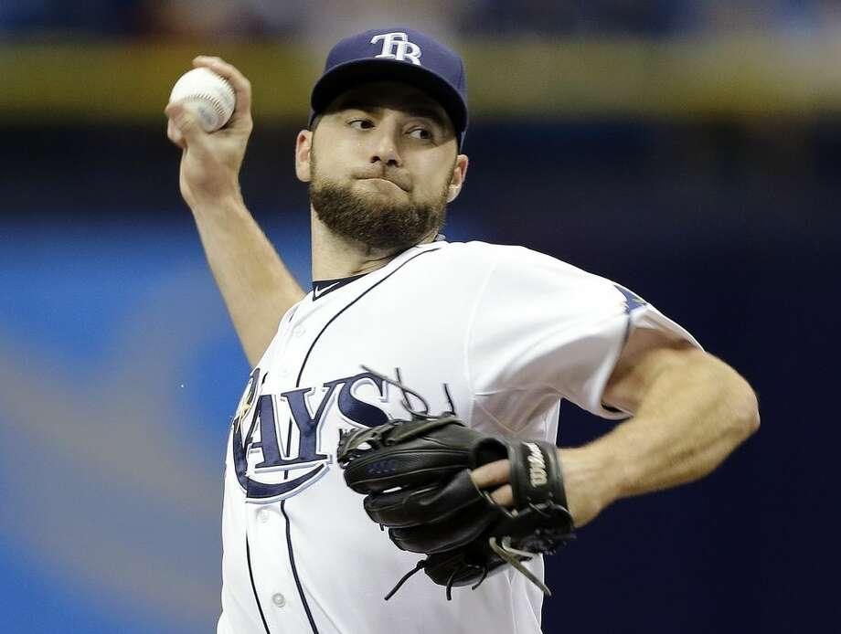Tampa Bay Rays starting pitcher Nathan Karns delivers to the New York Yankees during the first inning of a baseball game Wednesday, May 13, 2015, in St. Petersburg, Fla. (AP Photo/Chris O'Meara)