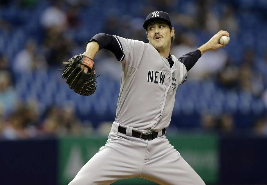 New York Yankees relief pitcher Andrew Miller delivers to the Tampa Bay Rays during the eighth inning of a baseball game Wednesday, May 13, 2015, in St. Petersburg, Fla. The Rays defeated the Yankees 3-2. (AP Photo/Chris O'Meara)