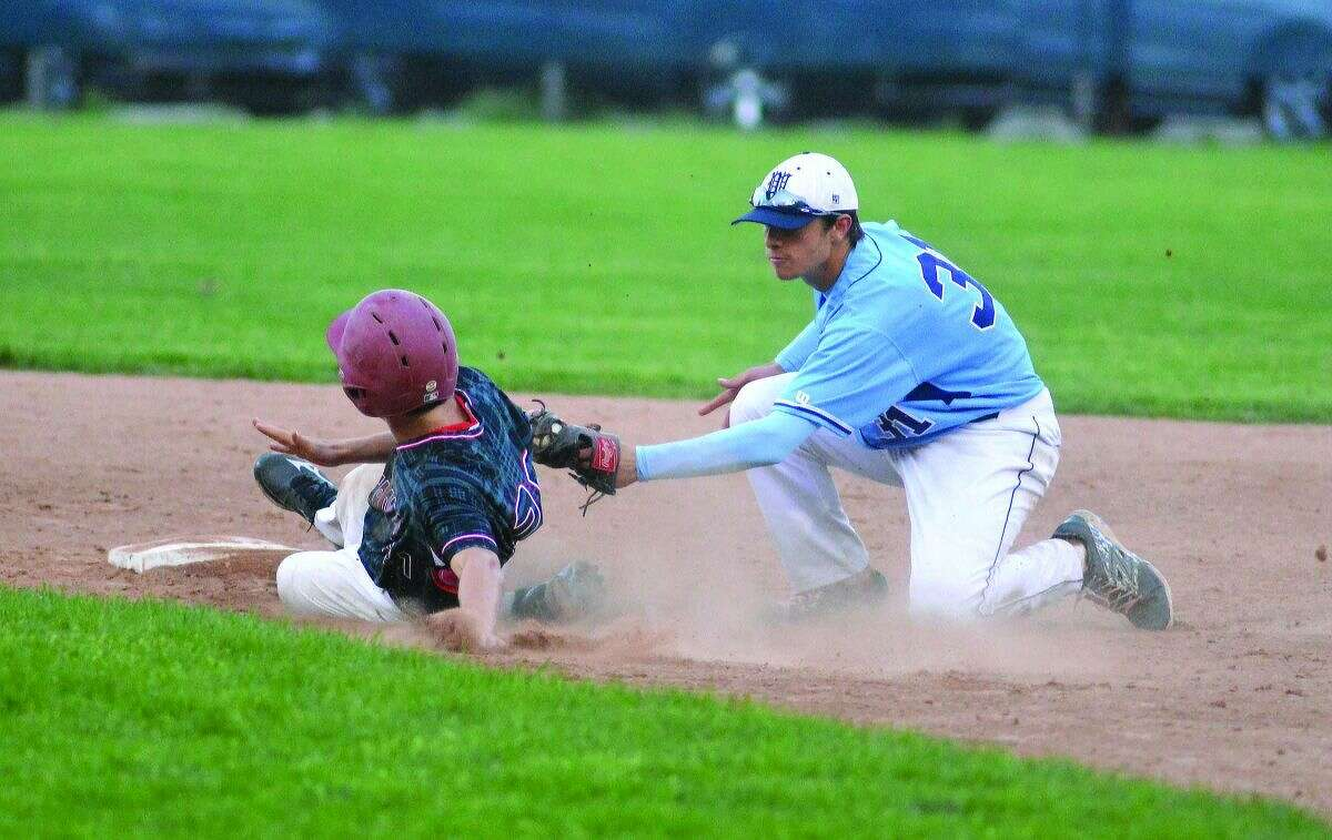 Hour Photo/Alex von Kleydorff. Wilton's Dillon Lifrieri makes the tag at second for the out vs New Canaan