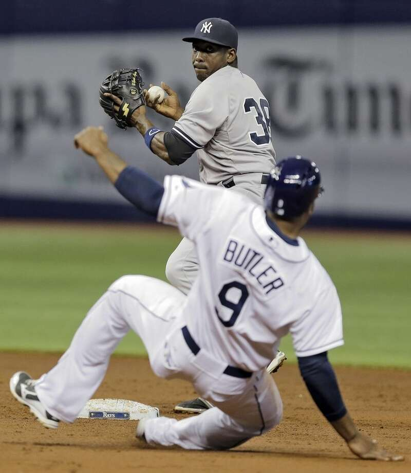 New York Yankees second baseman Jose Pirela (38) forces Tampa Bay Rays' Joey Butler (9) at second base and relays the throw to first base in time to turn a double play on Bobby Wilson during the second inning of a baseball game Wednesday, May 13, 2015, in St. Petersburg, Fla. (AP Photo/Chris O'Meara)