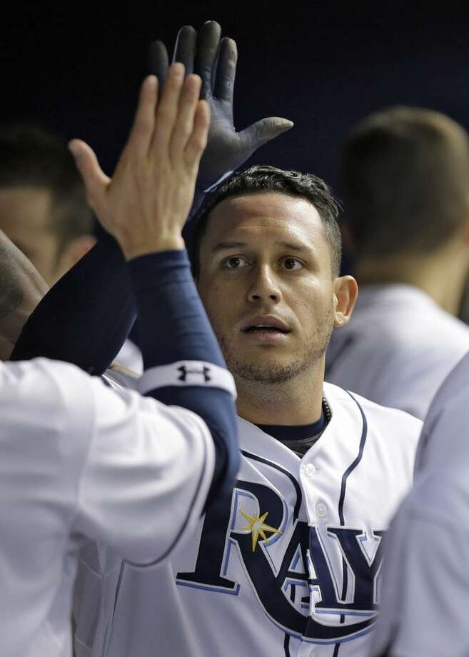 Tampa Bay Rays' Asdrubal Cabrera high fives teammates in the dugout after scoring on an Rbi single by Joey Butler off New York Yankees starting pitcher Adam Warren during the second inning of a baseball game Wednesday, May 13, 2015, in St. Petersburg, Fla. (AP Photo/Chris O'Meara)