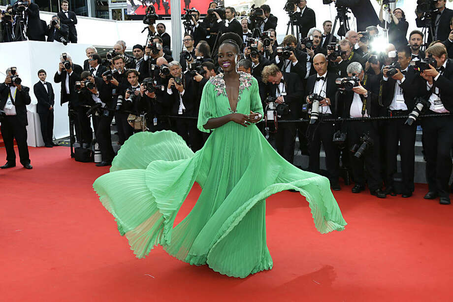 Lupita Nyong'o arrives for the opening ceremony and the screening of the film La Tete Haute (Standing Tall) at the 68th international film festival, Cannes, southern France, Wednesday, May 13, 2015. (Photo by Joel Ryan/Invision/AP)