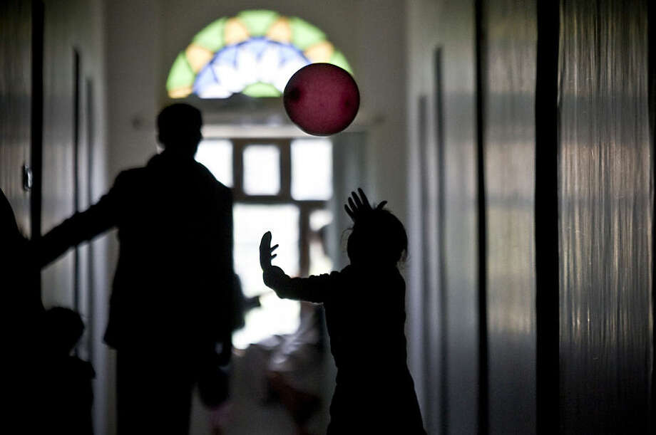 A girl plays with a balloon, inside a school where she is living with her displaced family who fled their home after a Saudi-led airstrike destroyed their houses, in Sanaa, Yemen, Thursday, May 14, 2015. The conflict in Yemen has killed more than 1,400 people — many of them civilians — since March 19, according to the U.N. The country of some 25 million people has endured shortages of food, water, medicine and electricity as a result of a Saudi-led blockade. (AP Photo/Hani Mohammed)
