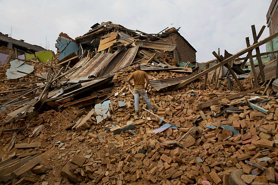 A man inspects an area that collapsed during the May 12 earthquake in Chautara, Nepal, Wednesday, May 13, 2015. Nepal, just beginning to rebuild after a devastating April 25 earthquake, was hit by a magnitude-7.3 quake Tuesday. (AP Photo/Bernat Amangue)