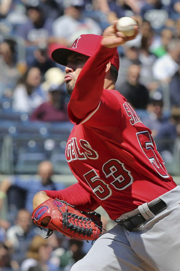 Los Angeles Angels starting pitcher Hector Santiago throws in the third inning of a baseball game against the New York Yankees at Yankee Stadium, Saturday, April 26, 2014, in New York. (AP Photo/John Minchillo)