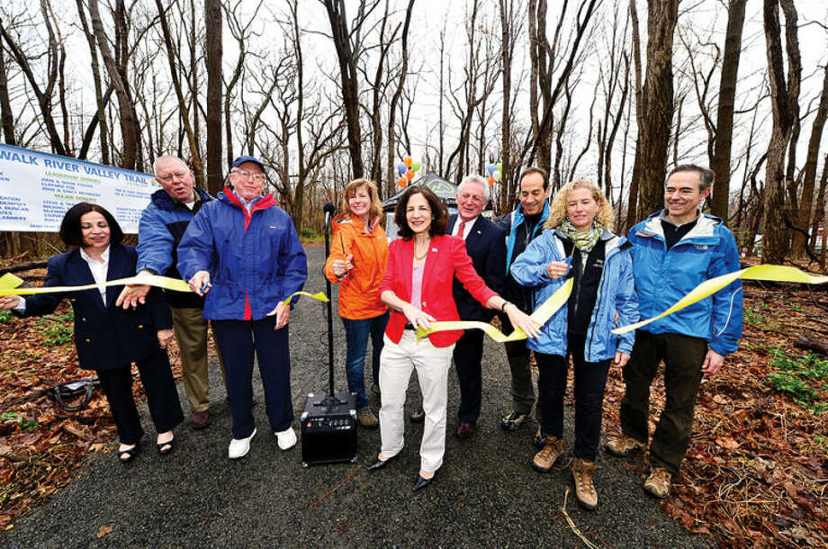 Hour photo / Erik Trautmann State Senator Toni Boucher, Redding Selectman Leon Kavelis, Wilton firest Selectman Bill Brennan, trail organizer Pat Sesto, State Representative Gail Lavielle, Norwalk mayor Harry Rilling, Jesse and Betsy Fink Greg Jansen cut the ribbon for The Norwalk River Valley Trail's Wilton Loop grand opening Saturday