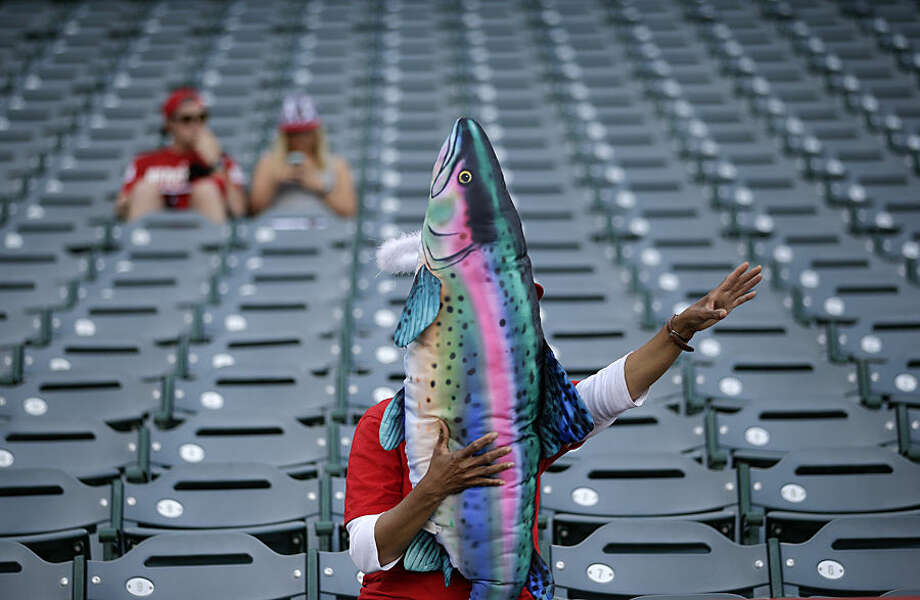 Dee Dee Deleon, of San Diego, holds a trout pillow autographed by Los Angeles Angels' Mike Trout before the Angels' baseball game against the Colorado Rockies, Wednesday, May 13, 2015, in Anaheim, Calif. (AP Photo/Jae C. Hong)