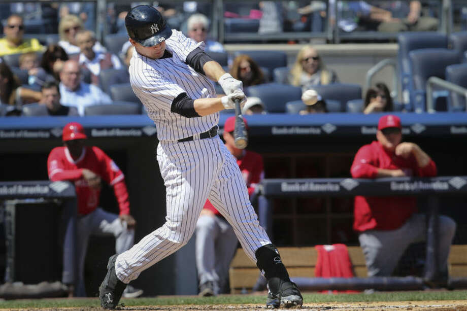 New York Yankees' John Ryan Murphy hits a single to drive in two runs in the second inning of a baseball game against the Los Angeles Angels at Yankee Stadium, Saturday, April 26, 2014, in New York. (AP Photo/John Minchillo)