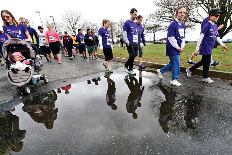 Hour photo / Erik Trautmann Walker set out on the 11th Annual Whittingham Cancer Center Walk & Sally's Run at Calf Pasture Beach Saturday where more than 2,500 participants from Fairfield County turned to support, celebrate and remember all those fighting cancer as well as those we have lost to this disease.