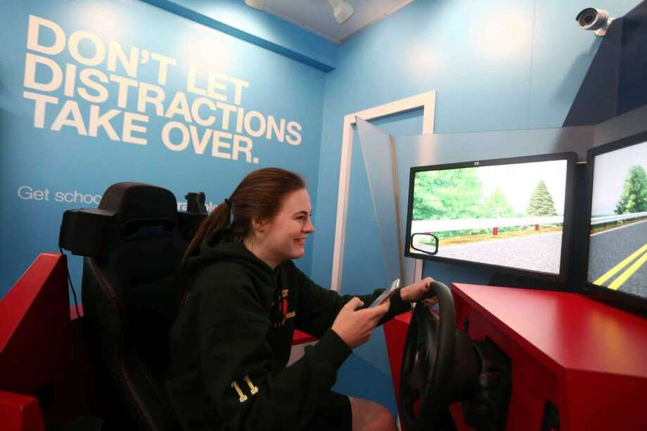 Trinity Catholic High School sophomore Grace Curley-Holmes, 16, drives the texting-while-driving simulation inside the distracted driving training simulator parked outside of Trinity Catholic on Thursday, May 5, 2016. (Photo: Michael Cummo / Hearst Connecticut Media)
