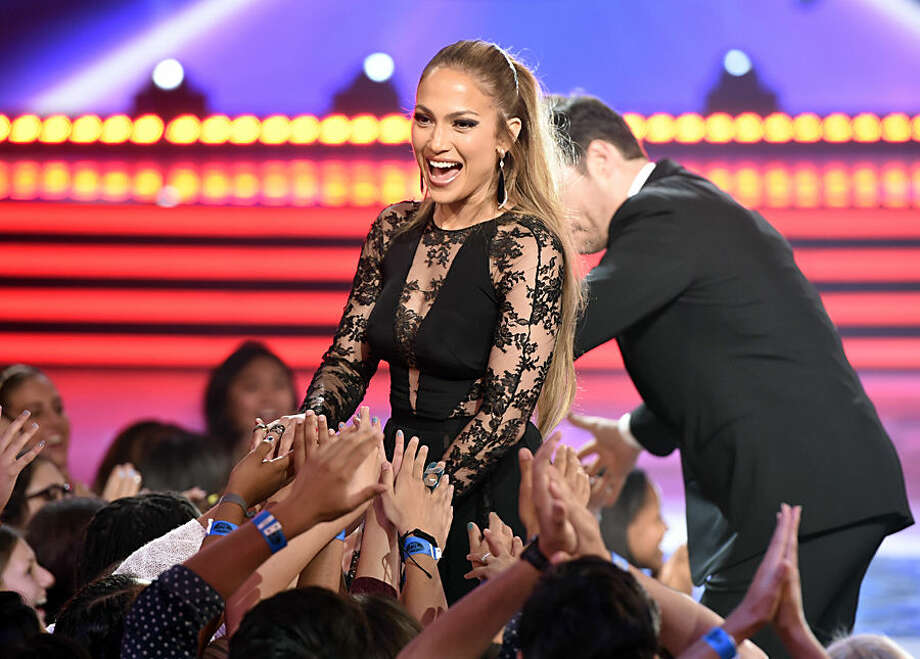 Judge Jennifer Lopez greets fans at the American Idol XIV finale at the Dolby Theatre on Wednesday, May 13, 2015, in Los Angeles. (Photo by Chris Pizzello/Invision/AP)