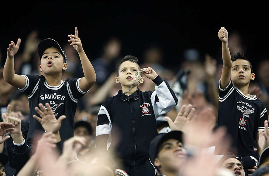 Fans of Brazil's Corinthians cheer prior to a Copa Libertadores round of sixteen soccer match against Paraguay's Guarani in Sao Paulo, Brazil, Wednesday, May 13, 2015. (AP Photo/Andre Penner)