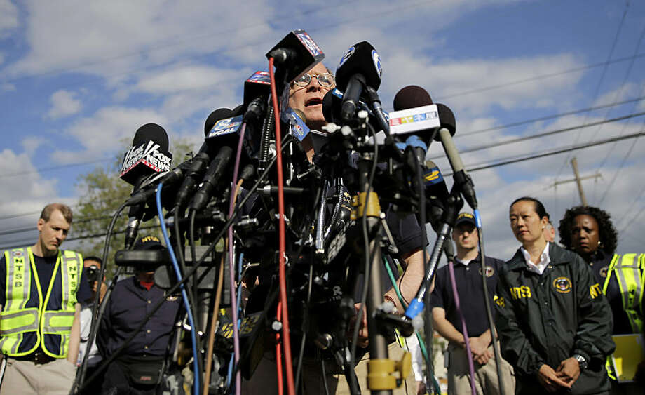 National Transportation Safety Board member Robert Sumwalt speaks at a news conference near the scene of a deadly Amtrak train wreck, Wednesday, May 13, 2015, in Philadelphia. Sumwalt said Wednesday that the train was traveling at 106 mph when the engineer hit the brakes Tuesday night. (AP Photo/Matt Slocum)