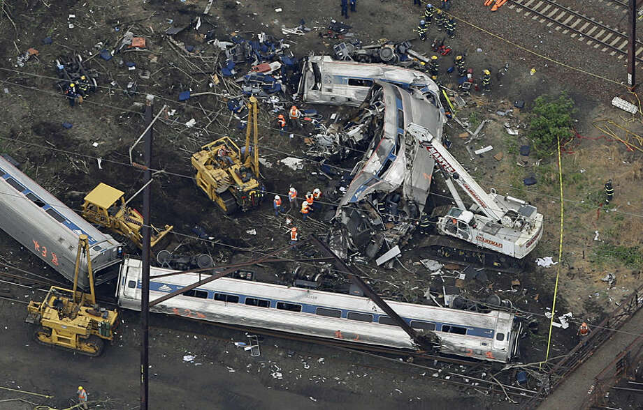 In this aerial photo, emergency personnel work at the scene of a deadly train wreck, Wednesday, May 13, 2015, in Philadelphia. Federal investigators arrived Wednesday to determine why an Amtrak train jumped the tracks in a wreck that killed at least six people, and injured dozens. (AP Photo/Patrick Semansky)