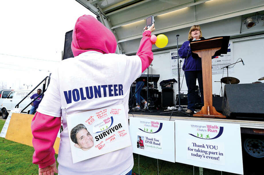 Hour photo / Erik Trautmann Erin Herring reads a proclamation for the mayor of Norwalk during the 11th Annual Whittingham Cancer Center Walk & Sally's Run at Calf Pasture Beach Saturday where more than 2,500 participants from Fairfield County turned to support, celebrate and remember all those fighting cancer as well as those we have lost to this disease.