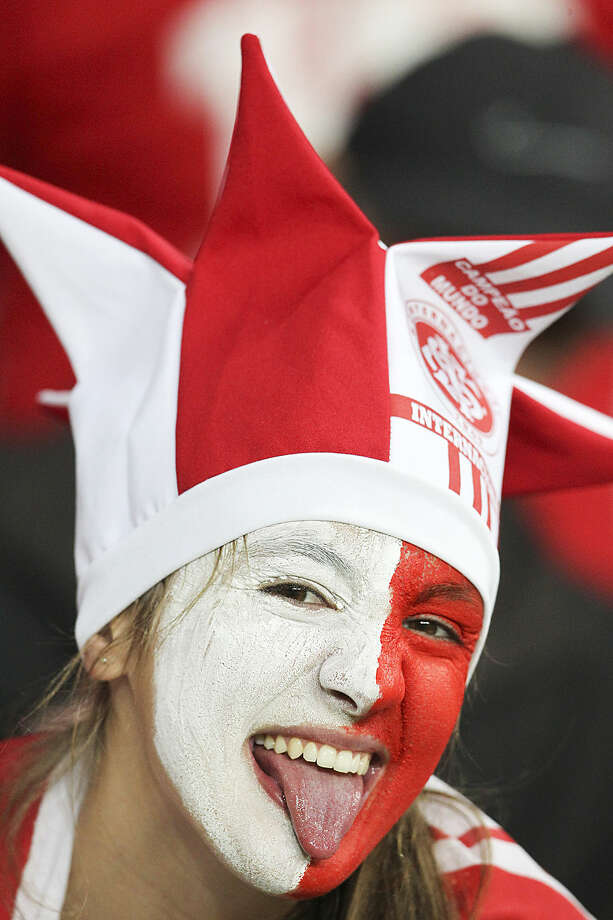 A soccer fan of Brazil's Internacional, poses for a photo before the start of a Copa Libertadores round of sixteen soccer match against Brazil's Atletico Mineiro in Porto Alegre, Brazil, Wednesday, May 13, 2015. (AP Photo/Nabor Goulart)
