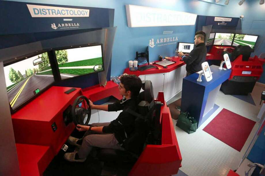 Trinity Catholic senior Matt Lombardo, 18l, drives Bearingstar Insurance's distracted driving training mobile on Thursday, May 5, 2016. The trailer holds two independent driving simulators, with each full simulation lasting approximately 40 minutes. (Photo: Michael Cummo / Hearst Connecticut Media)