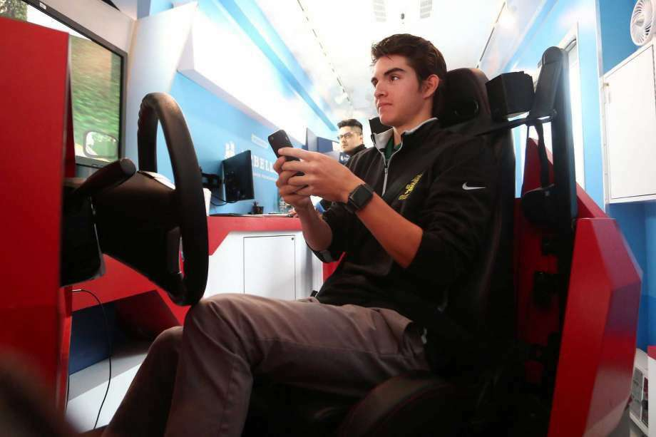 18-year old Matt Lombardo, a senior at Trinity Catholic High School, drives in a texting-while-driving simulation inside Bearingstar Insurance's distracted driving training mobile on Thursday, May 5, 2016. Other simulations include sudden stops, blind stop signs and pedestrian crossings. (Photo: Michael Cummo / Hearst Connecticut Media)
