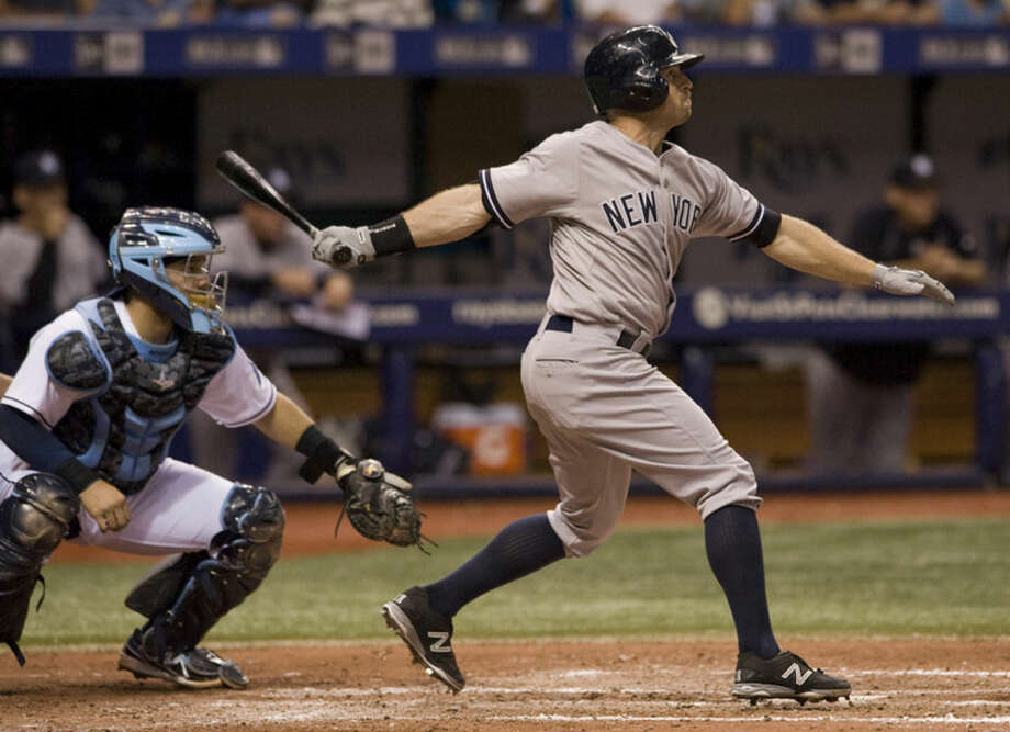 Tampa Bay Rays catcher Rene Rivera, left, looks on as New York Yankees' Brett Gardner hits a three-run homer off Tampa Bay starter Alex Colome during the sixth inning of a baseball game Monday, May 11, 2015, in St. Petersburg, Fla. (AP Photo/Steve Nesius)