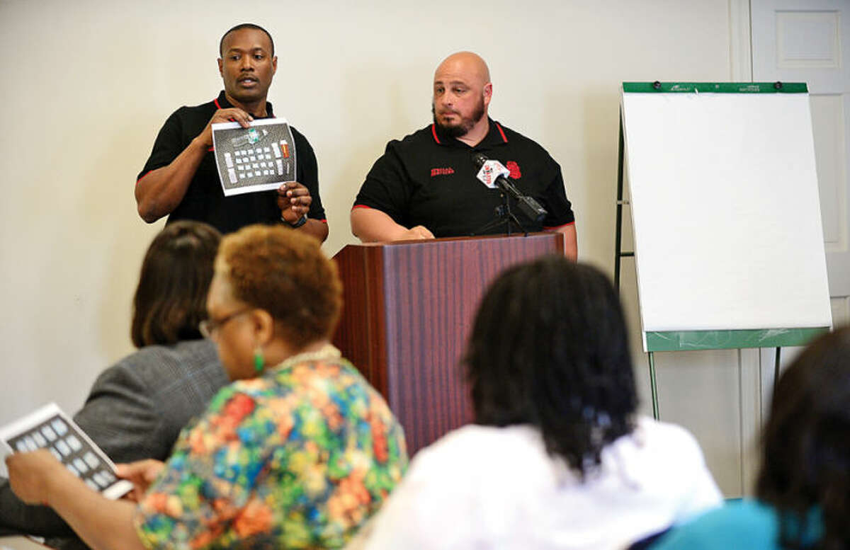 Hour photo / Erik Trautmann Norwalk police officers Mark Suda and Max Sixto speak at The Human Services Council's Mid-Fairfield Substance Abuse Coalition community forum on heroin and prescription drug abuse Tuesday at HSC in Norwalk.
