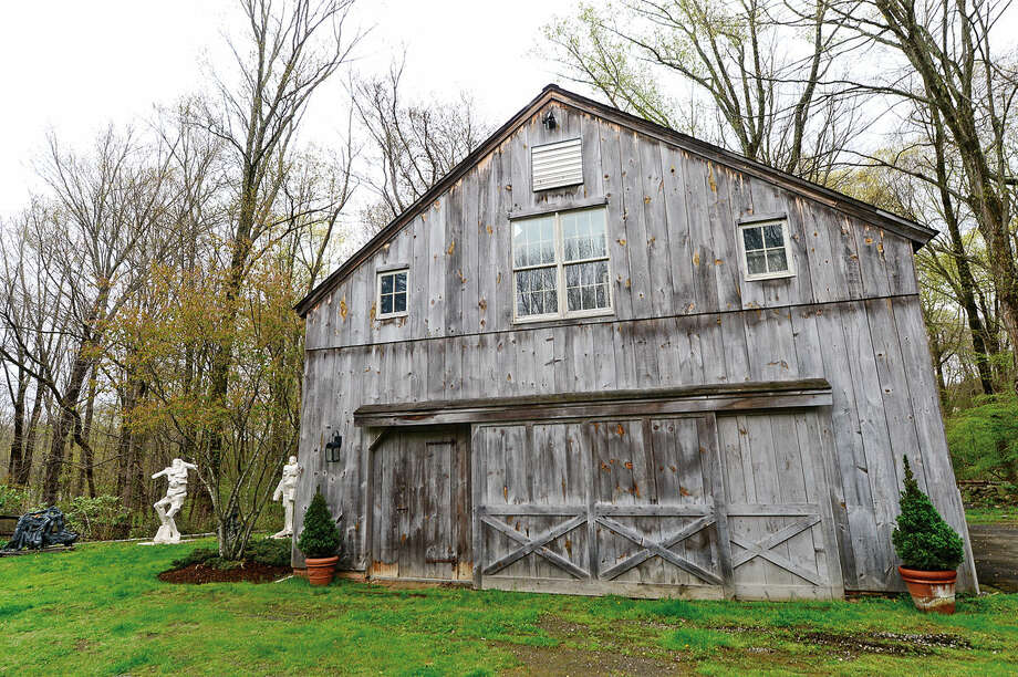 The home at 37 Godfrey Road in Weston, Conn. on Wednesday, May 5, 2016 is on the market for $1.4 million. The second building on the property, a restored 19th century barn, was moved from Redding in the 1990's and housed a sculpting studio.