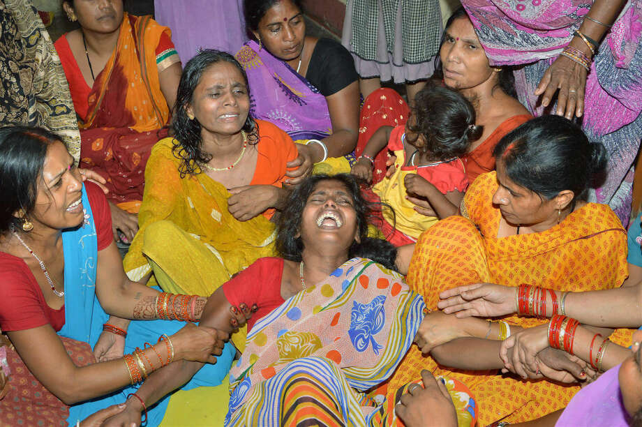 Women mourn the death of a family member after a wall collapsed in an earthquake in Danapur, on the outskirts of Patna, in the eastern Indian state of Bihar, Tuesday, May 12, 2015. Strong shaking was felt across northern India, with some deaths reported when rooftops or walls collapsed on them in the state of Bihar. A major earthquake hit a remote mountain region of Nepal on Tuesday, triggering landslides and toppling buildings less than three weeks after the Himalayan nation was ravaged by its worst quake in decades. (Press Trust of India via AP)
