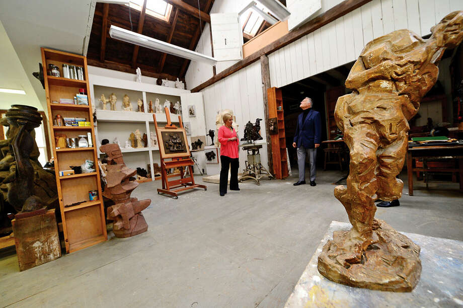 Owner Leslie Emanual brings real estate agent Albert Angotti through her home at 37 Godfrey Road in Weston, Conn. on Wednesday, May 5, 2016 which is listing for $1.4 million. The second building on the property, a restored 19th century barn, was moved from Redding in the 1990's and houses a sculpting studio.