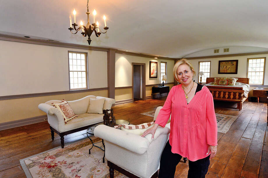 Owner Leslie Emanual in the former dance hall of the restored 18th century tavern she calls home at 37 Godfrey Road in Weston, Conn. on Wednesday, May 5, 2016. The home which was moved from Sheffield, Massachussetts in the 1980's and is on the market for $1.4 million.