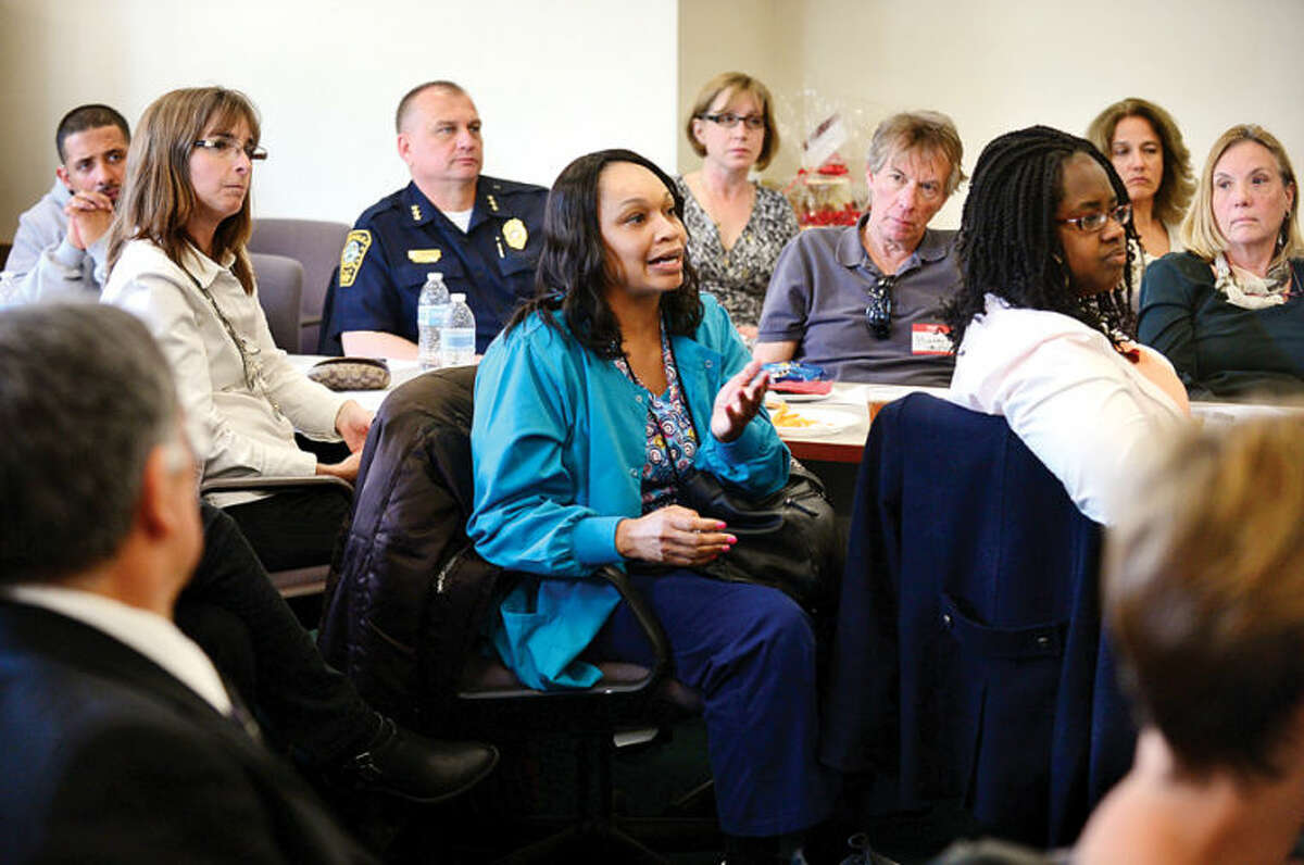 Hour photo / Erik Trautmann Norwalk Community Health Center nurse Tanya Moore asks a question during The Human Services Council's Mid-Fairfield Substance Abuse Coalition community forum on heroin and prescription drug abuse on Tuesday at HSC.