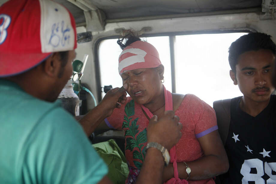 An Injured Nepalese woman cries as she is taken to hospital after an earthquake hit Kathmandu, Nepal, Tuesday, May 12, 2015. A major earthquake has hit Nepal near the Chinese border between the capital of Kathmandu and Mount Everest less than three weeks after the country was devastated by a quake. (AP Photo/Niranjan Shrestha)