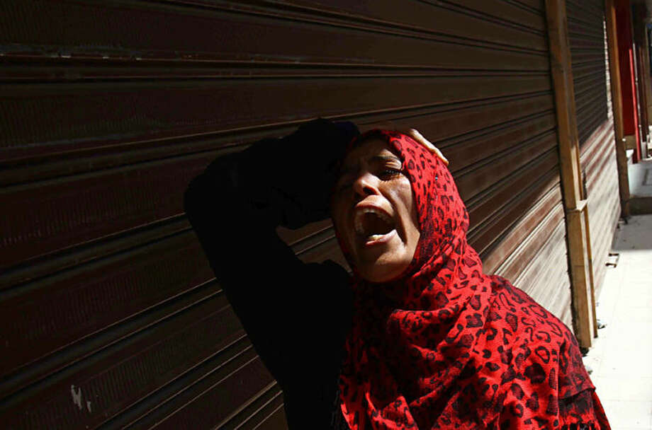 An Egyptian woman mourns after a judge sentenced to death 683 alleged supporters of the country's ousted Islamist president over acts of violence and the murder of policemen in the latest mass trial in the southern city of Minya, Egypt, Monday, April 28, 2014. Under the law, Monday's verdicts in Minya have to be referred to Egypt's Grand Mufti, the top Islamic official, said one of the attorneys, Ahmed Hefni. (AP Photo/Ahmed Gomaa)