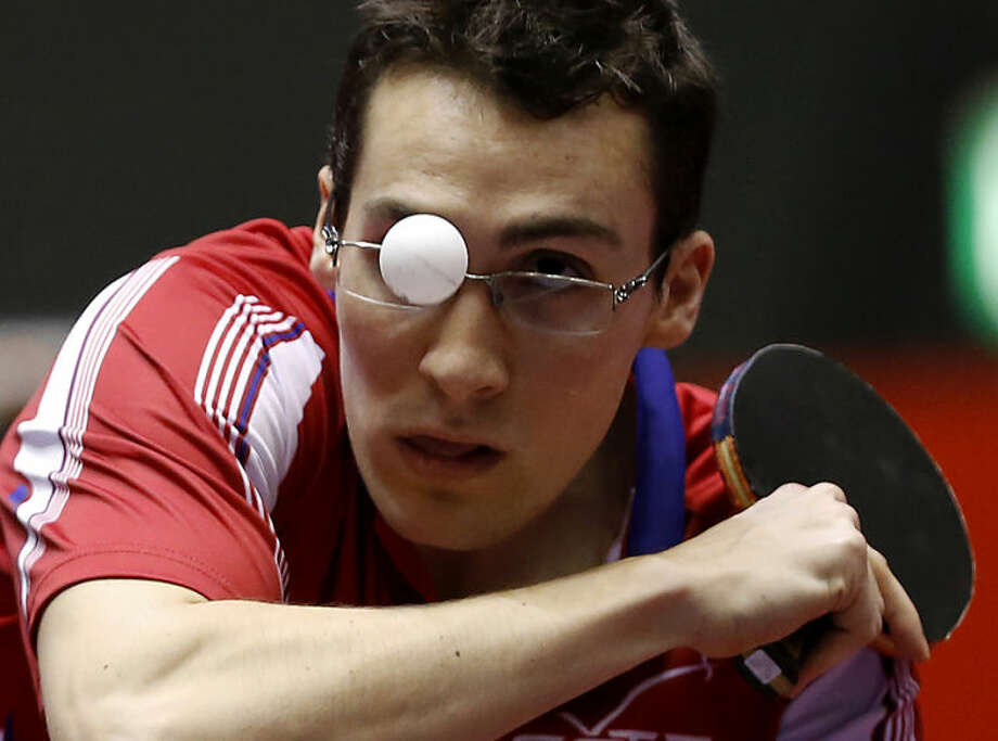 Adrien Mattenet of France watches the ball during his round robin match of the World Team Table Tennis Championships against Tiago Apolonia of Portugal in Tokyo, Tuesday, April 29, 2014. (AP Photo/Shizuo Kambayashi)