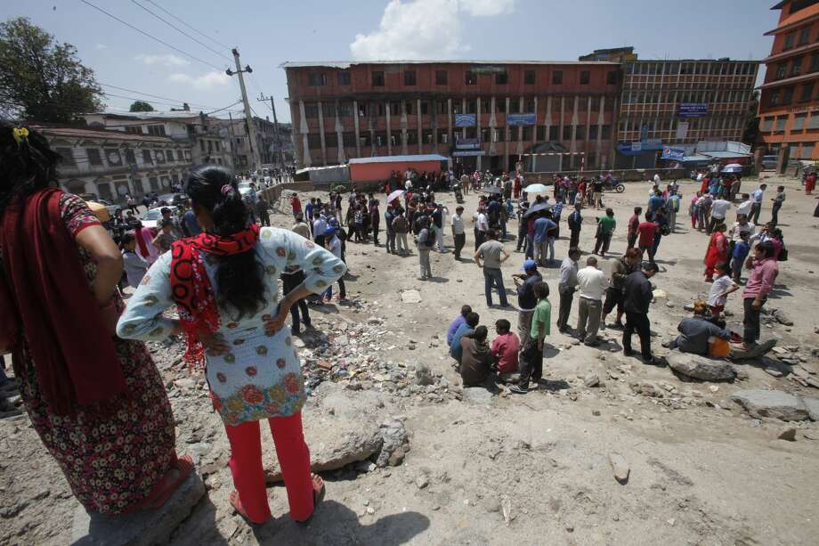 Nepalese people gather in an open area after a second earthquake hit them in Kathmandu, Nepal, Tuesday, May 12, 2015. A major earthquake hit a remote mountainous region of Nepal on Tuesday, triggering landslides and toppling buildings less than three weeks after the country was ravaged by another deadly quake. (AP Photo/Bikram Rai)