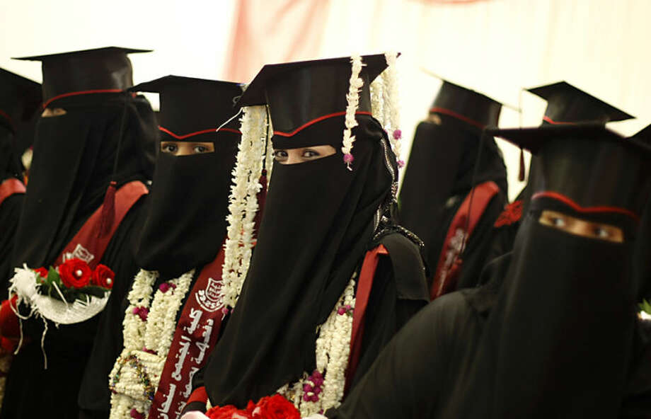 Yemeni female university students celebrate during their graduation ceremony in Sanaa, Yemen, Monday, April 28, 2014. According to the government, the illiteracy rate in Yemen stands at 70 percent in the countryside, and in the cities up to 38 percent. Traditionally, female Yemenis rarely study past the 6th grade. Lately, however, girls in larger cities like Sanaa are finishing high school, with some going on to higher education. (AP Photo/Hani Mohammed)