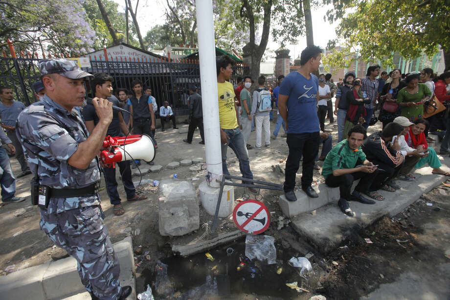 A policeman uses a loudspeaker to direct the public to safer areas after an earthquake hit Kathmandu, Nepal, Tuesday, May 12, 2015. A major earthquake hit Nepal in a remote region near the Chinese border on Tuesday, less than three weeks after the country was ravaged by another deadly quake. (AP Photo/Bikram Rai)