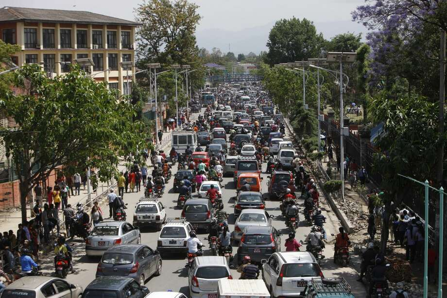 Traffic grinds to a halt after an earthquake hit Nepal in Kathmandu, Nepal, Tuesday, May 12, 2015. A major earthquake hit a remote mountainous region of Nepal on Tuesday, triggering landslides and toppling buildings less than three weeks after the country was ravaged by another deadly quake. (AP Photo/Bikram Rai)