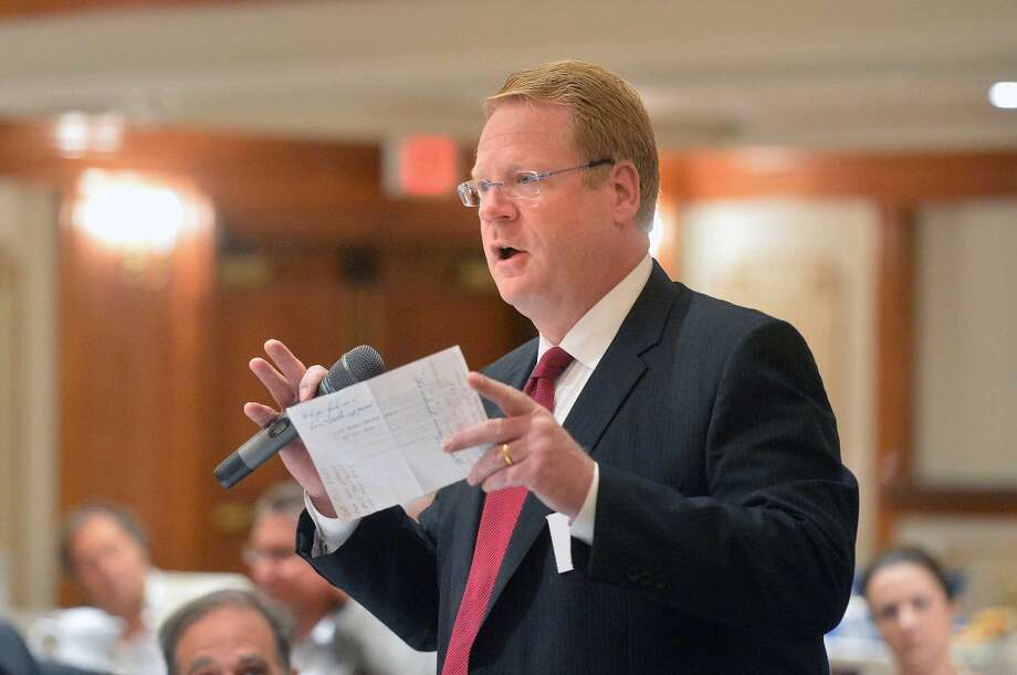 Hour Photo/Alex von Kleydorff David McCarthy asks a question about a proposed tax bill in Hartford during The Greater Norwalk Chamber of Commerce Legislative Breakfast Tuesday morning