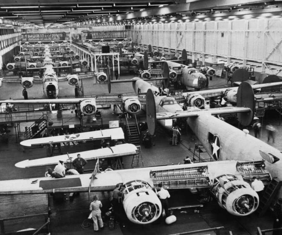 FILE - In this March 3, 1943, file photo workers assemble B-24 Liberator bombers at Ford's Willow Run plant in Ypsilanti Township, Mich. A group wants to preserve a portion of the plant and house a museum there dedicated to aviation and the countless Rosie the Riveters across the country. Save the Bomber Plant officials have until Thursday, May 1, 2014 to raise the remainder of the $8 million needed to save the plant from demolition. (AP Photo/File)
