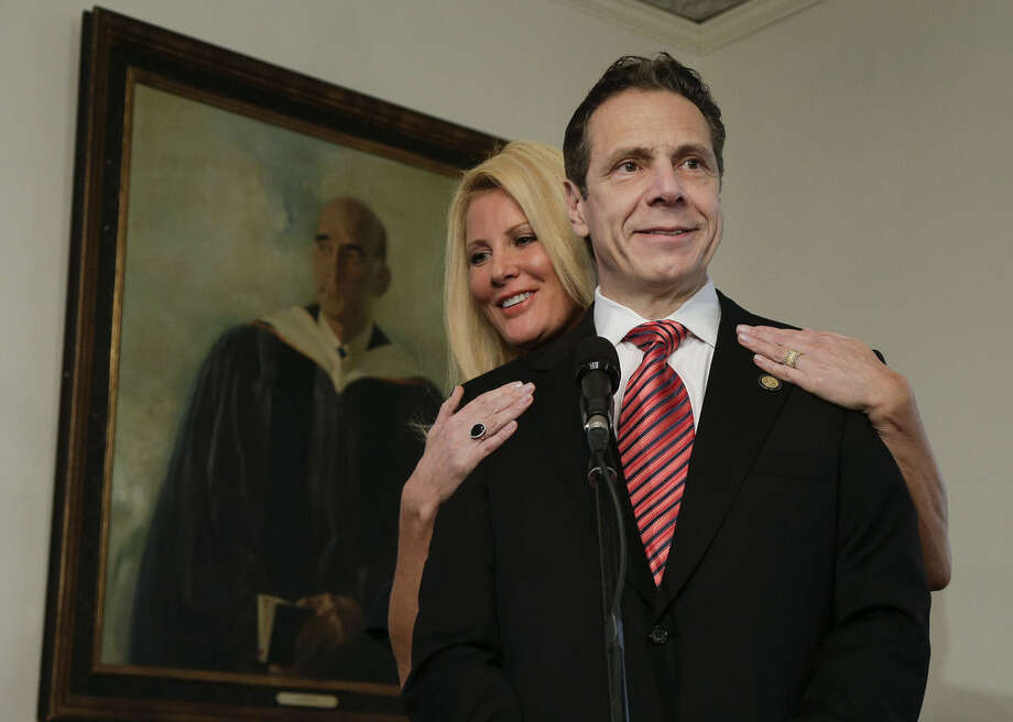 "FILE - In this Tuesday, Nov. 4, 2014, file photo, New York Gov. Andrew Cuomo speaks to members of the media as his partner, Sandra Lee, looks on after casting his ballot, in Mount Kisco, N.Y. In an interview that aired Tuesday, May 12, 2015, on ABC's ""Good Morning America, "" Lee said she has been diagnosed with breast cancer. (AP Photo/Julie Jacobson, File)"