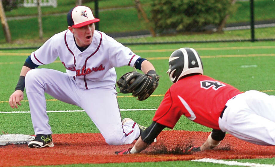 Fairfield Warde High School baseball player #4 John Natoli runs into the tag of Brien McMahon shortstop Chris Giordano during their FCIAC baseball game Saturday May 7, 2016, in Norwalk, Conn.